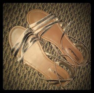 Cute gold wrap around sandals.  Marked 8.5